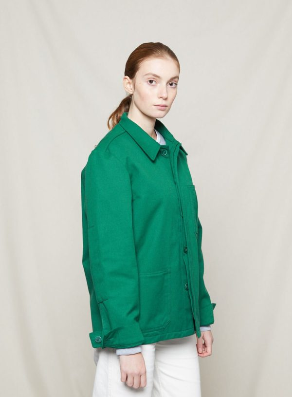 woman wearing bottle green worker jacket