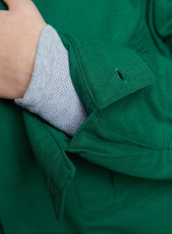 cuff detail on bottle green worker jacket