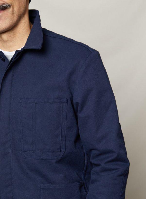 navy worker jacket worn shoulder detail