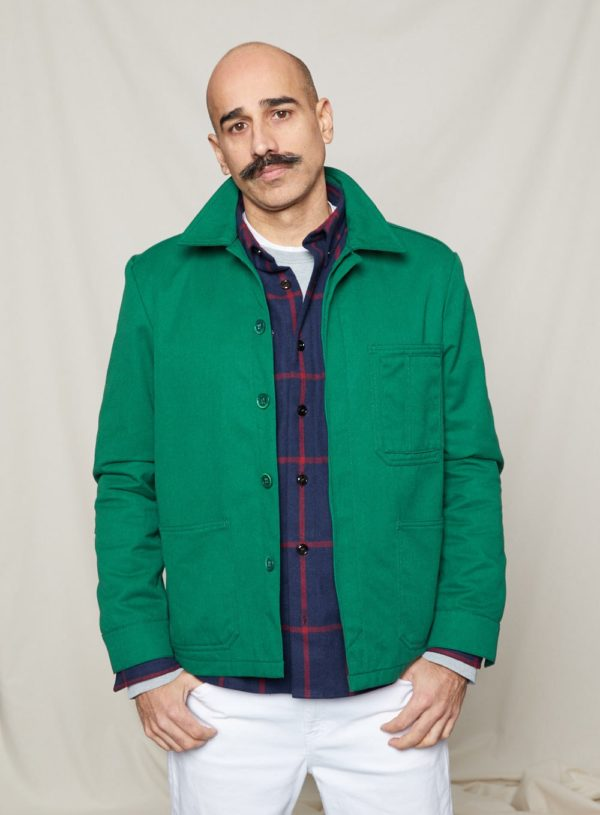 bottle green worker jacket worn over navy and red tile overshirt