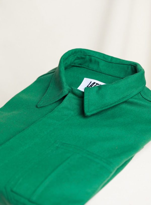 folded worker jacket in bottle green