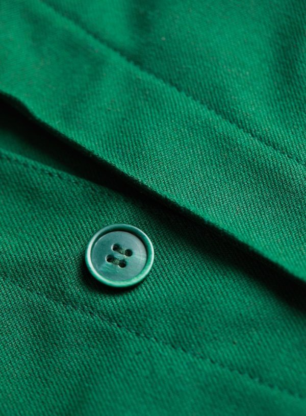 green button on bottle green worker jacket