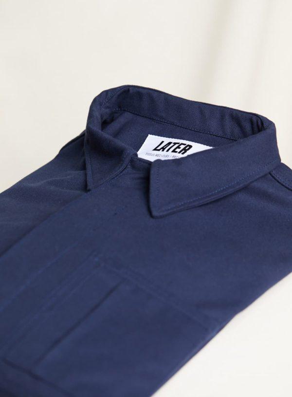 folded navy worker jacket